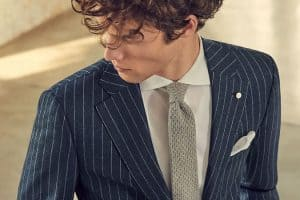 Why You Should Own A Pinstripe Suit (And How To Wear It)